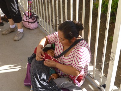 P1020739 Saleswoman with baby (Medium)